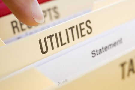 filing document: Files Containing Utility Bills Stock Photo