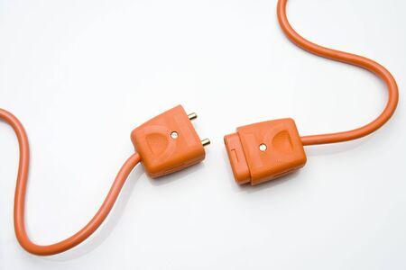 enchufe: Dos enchufes el�ctricos de naranja Foto de archivo