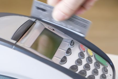 cashless: Swiping Credit Card Stock Photo