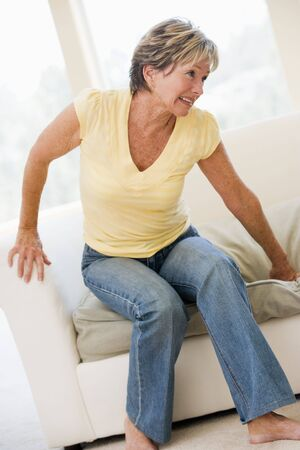 wincing: Woman Suffering With Back Pain Stock Photo
