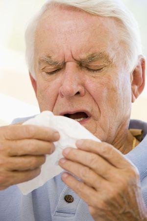 wincing: Senior Man Sneezing
