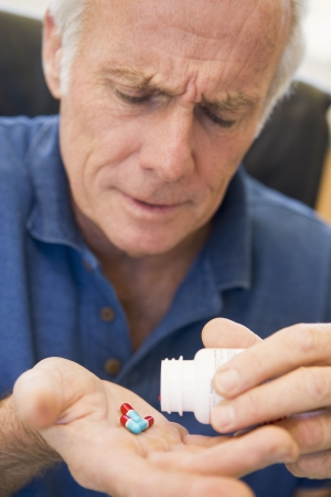Senior Man Pouring Pills Out Of Bottle Stock Photo - 3723172