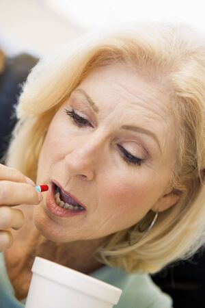 swallowing: Woman Swallowing Pill