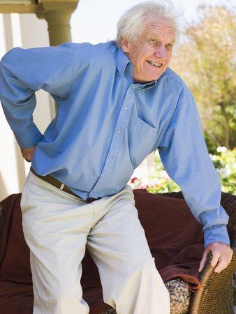 seniors suffering painful illness: Man With Back Pain Stock Photo