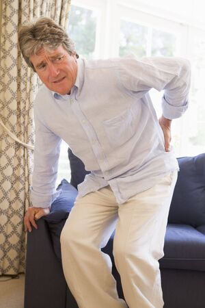 suffering: Man With Back Pain Stock Photo