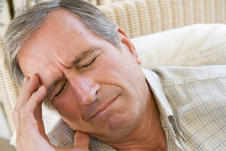 wincing: Man With A Headache Stock Photo