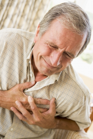elderly pain: Man Clutching His Heart Stock Photo