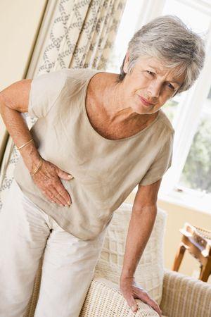 elderly pain: Donna Feeling Unwell Archivio Fotografico