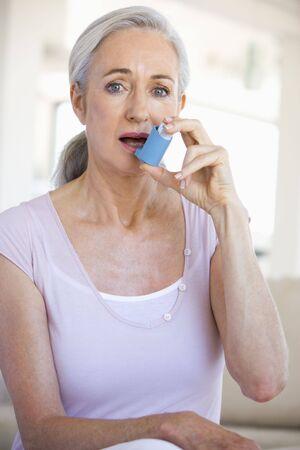 inhaler: Woman Using An Inhaler