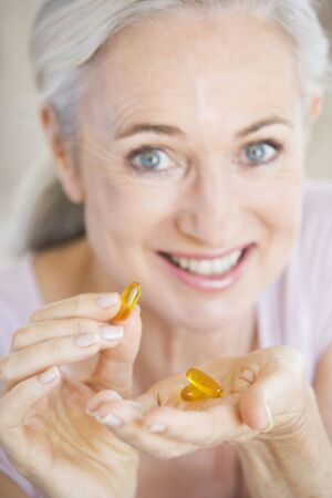 Woman Taking Pills photo