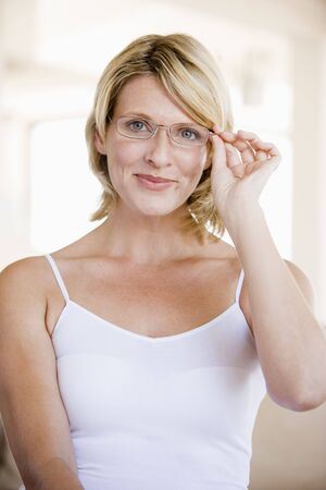 woman wearing glasses: Woman Looking Through New Glasses