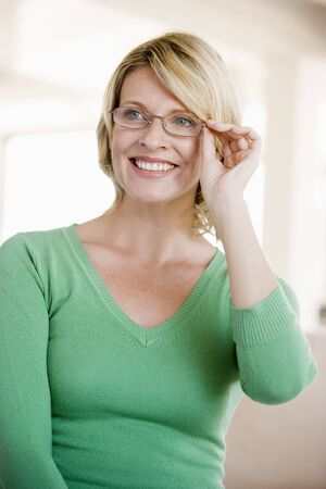 wearing glasses: Woman Looking Through New Glasses
