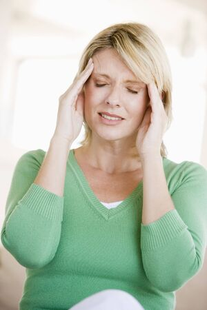 wincing: Woman With A Headache Stock Photo