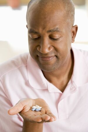Man Taking Pills photo
