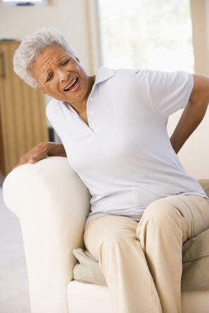 seniors suffering painful illness: Woman With Back Pain