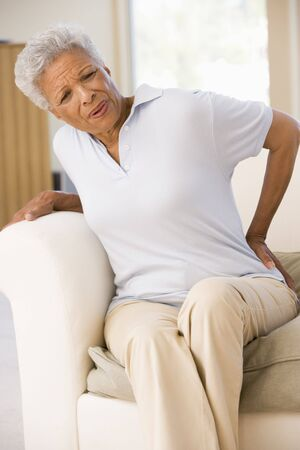 back ache: Woman With Back Pain