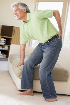 leaning over: Man With Back Pain Stock Photo