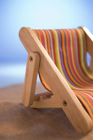 Miniature Deck Chair On Sand photo