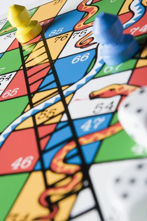 snakes and ladders: Close -Up Of Snakes And Ladders Board