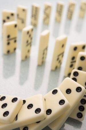 Arrangement Of Domino Pieces Collapsing photo