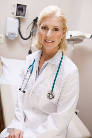 Middle Aged Female Doctor Sitting In A Hospital Ward Stock Photo - 3723756