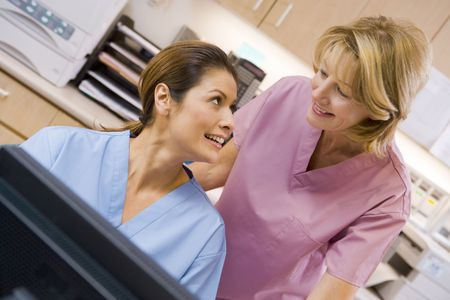 nurses station: Nurses At The Reception Area Of A Hospital