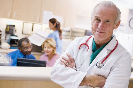 Doctors And Nurses At The Reception Area Of A Hospital Stock Photo - 3723996