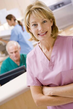 nurses station: Nurses In The Reception Area Of A Hospital