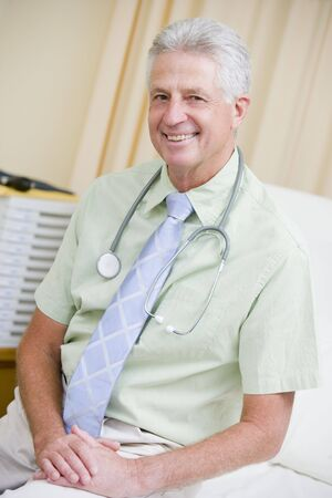 A Doctor Sitting On A Hospital Bed Stock Photo - 3724590