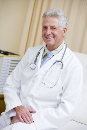 A Doctor Sitting On A Hospital Bed Stock Photo - 3723724