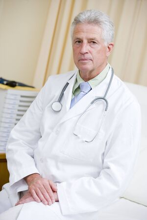 A Doctor Sitting On A Hospital Bed Stock Photo - 3723878