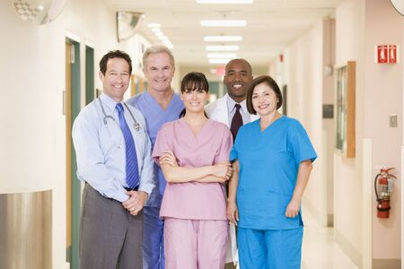 medical personnel: Hospital Team Standing In A Corridor