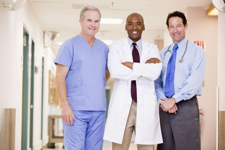 Doctors Standing In A Hospital Corridor photo