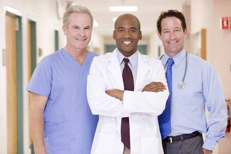Doctors Standing In A Hospital Corridor photo