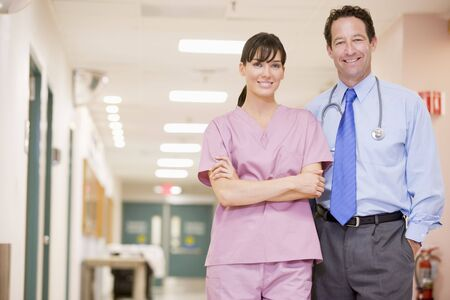 hospital corridor: Doctor And Nurse Standing In A Hospital Corridor