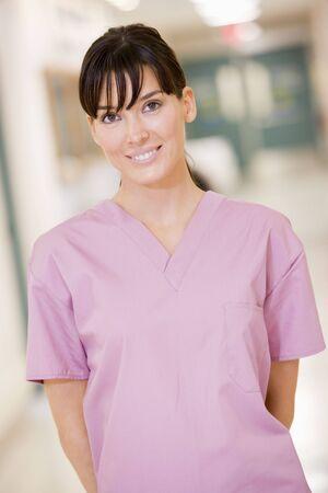 Nurse Standing In A Hospital Corridor photo