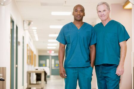 hospital corridor: Two Orderlies Standing In A Hospital Corridor