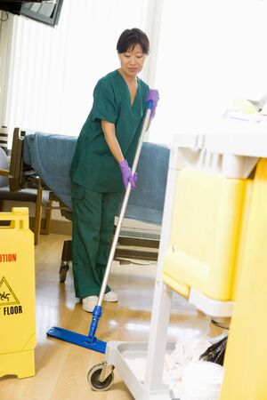 An Orderly Mopping The Floor In A Hospital Ward Stock Photo, Picture ...