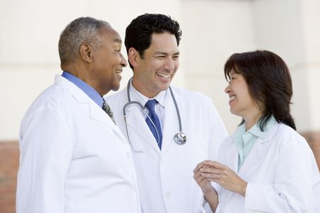 asian hospital: Three Doctors Standing Outside A Hospital Stock Photo