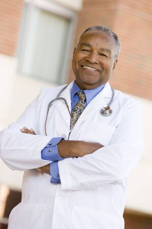 Doctor Standing Outside A Hospital photo