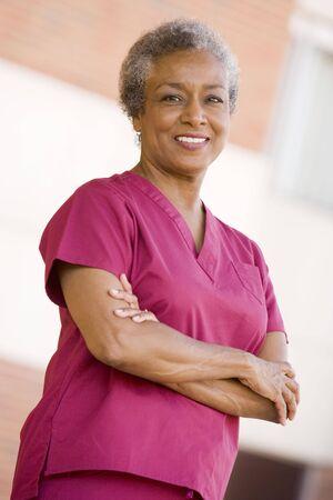 Nurse Standing Outside A Hospital Stock Photo - 3724412