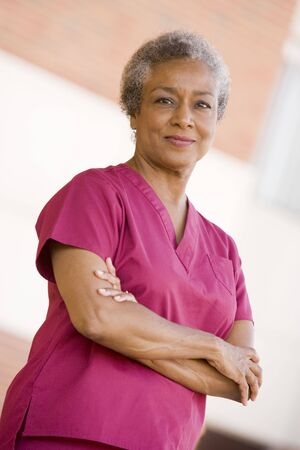 image consultant: Nurse Standing Outside A Hospital