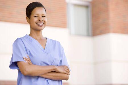 Nurse Standing Outside A Hospital photo