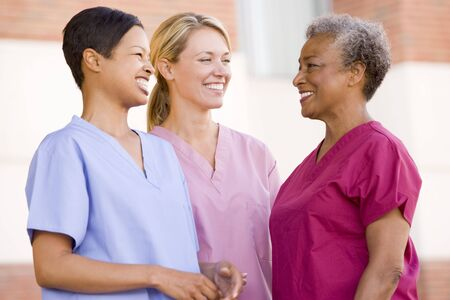 medical personnel: Nurses Standing Outside A Hospital Stock Photo