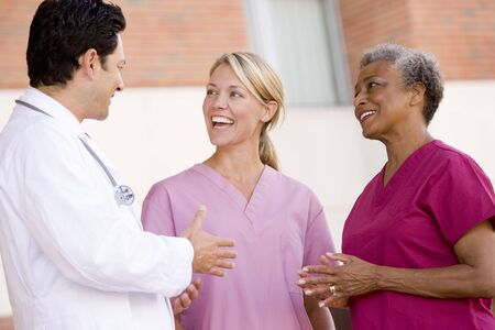image consultant: Doctor And Nurses Standing Outside A Hospital