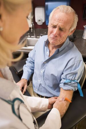 Middle Aged Man Having Blood Test Done Stock Photo - 3724591