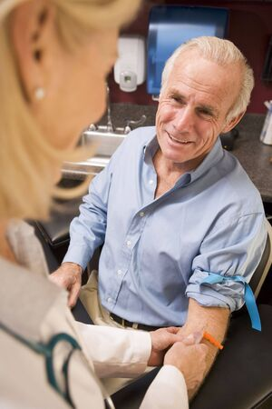 Middle Aged Man Having Blood Test Done photo