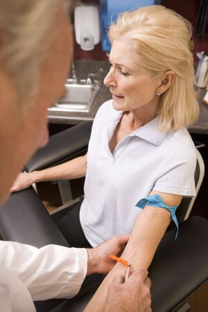 Middle Aged Woman Having Blood Test Done photo