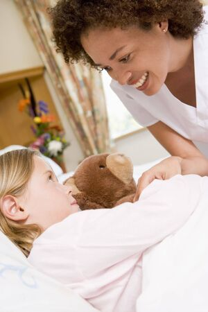 Nurse Checking Up On Young Girl In Hospital Stock Photo - 3724145
