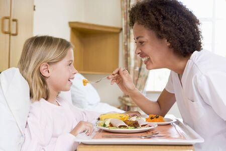 Nurse Feeding Young Girl photo